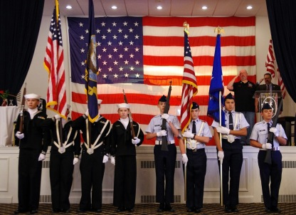 Civil Air Patrol cadets from the Putnam County Composite Squadron (r) and U.S. Naval Sea cadets (l) from the Hudson Valley Squadron, provide the color guard for the 2019 Veterans Chow Down. Civil Air Patrol cadets: C/SMSgt Evan Regan, C/MSgt Steven Johnston, C/CMSgt Jaime Virola and C/CMSgt Diego Gonzalez. (Photo by Major Peter Milano, New York Wing)